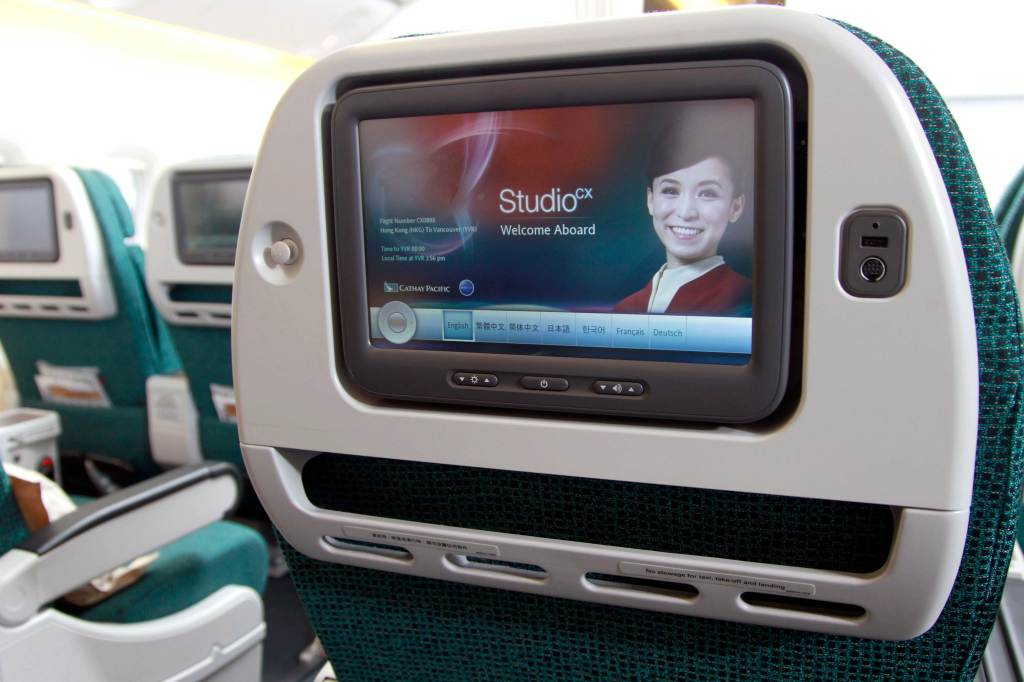 Cathay Pacific premium economy has a useful and size-agnostic device shelf instead of a restricted slot. --PR
