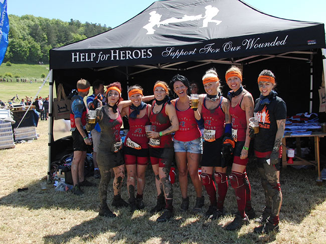 The 2013 Tough Mudder team sporting their sought after headbands and well earned pint